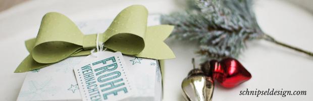 box mit geschenkschleife schnipseldesign